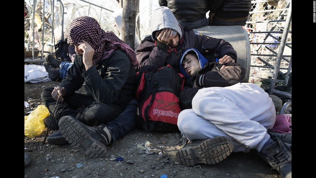 Migrants lay exhausted waiting to enter Macedonia.