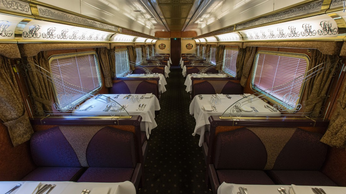 The Ghan's Queen Adelaide Restaurant. The menu highlights Australia's exotic local fare, like saltwater barramundi fish and grilled kangaroo fillet.
