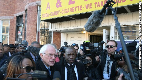 BALTIMORE, MD - DECEMBER 08:  Democratic presidential candidate Sen. Bernie Sanders, (I-VT) is given a tour of Sandtown-Winchester Neighborhood where Freddie Gray lived and was arrested, December 8, 2015 in Baltimore, Maryland. Sen. Sanders later met with African-American religious and civic leaders.  (Photo by Mark Wilson/Getty Images)