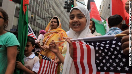 NEW YORK - SEPTEMBER 26:  Participants wait for the  start of the American Muslim Day Parade on September 26, 2010 in New York, New York. The annual parade celebrates the presence and contributions of Muslims in New York City and surrounding areas. The parade, which attracts hundreds of participants, concludes with a bazaar selling food, clothing, and books from various Muslim nations.  (Photo by Spencer Platt/Getty Images)