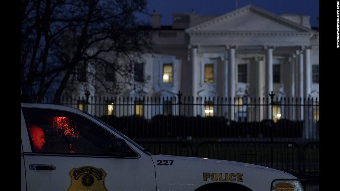 "A member of the Secret Service's Uniformed Division sits in his car outside the White House after a small drone <a href=""http://www.cnn.com/2015/01/26/politics/white-house-device-secret-service/"" target=""_blank"">crashed on the premises</a> Monday, January 26. The drone posed no threat, said a spokesman for President Obama, and Obama was in India at the time. The drone's owner and operator worked for the National Geospatial-Intelligence Agency, a government entity with mapping and national security duties. The agency confirmed that one of its employees was the operator of the drone, saying the employee was off-duty and the drone flight was not work-related."