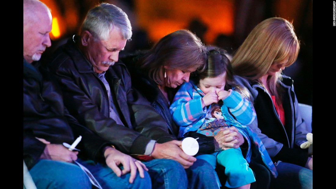 "Carl Mueller, second from left, sits next to his wife, Marsha, as they honor their daughter Kayla with a candlelight vigil in Prescott, Arizona, on Wednesday, February 18. Kayla, a 26-year-old American aid worker, <a href=""http://www.cnn.com/2015/02/10/world/isis-hostage-mueller/index.html"" target=""_blank"">was killed by the militant group ISIS.</a> She had been captured in northern Syria in 2013."