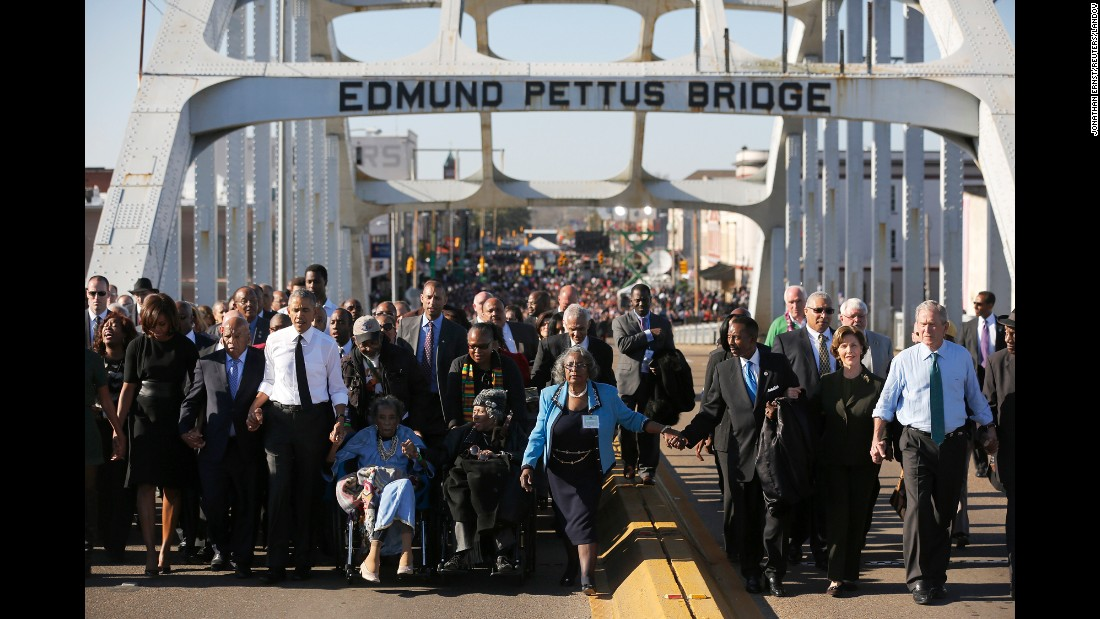 "President Barack Obama, on the left in the white shirt, and former President George W. Bush, on the far right, march across the Edmund Pettus Bridge in Selma, Alabama, on Saturday, March 7. Their wives also joined them for the event, which was held 50 years after <a href=""http://www.cnn.com/2015/01/06/us/gallery/selma-bloody-sunday-1965/index.html"" target=""_blank"">marchers were brutally beaten</a> as they demonstrated for voting rights."