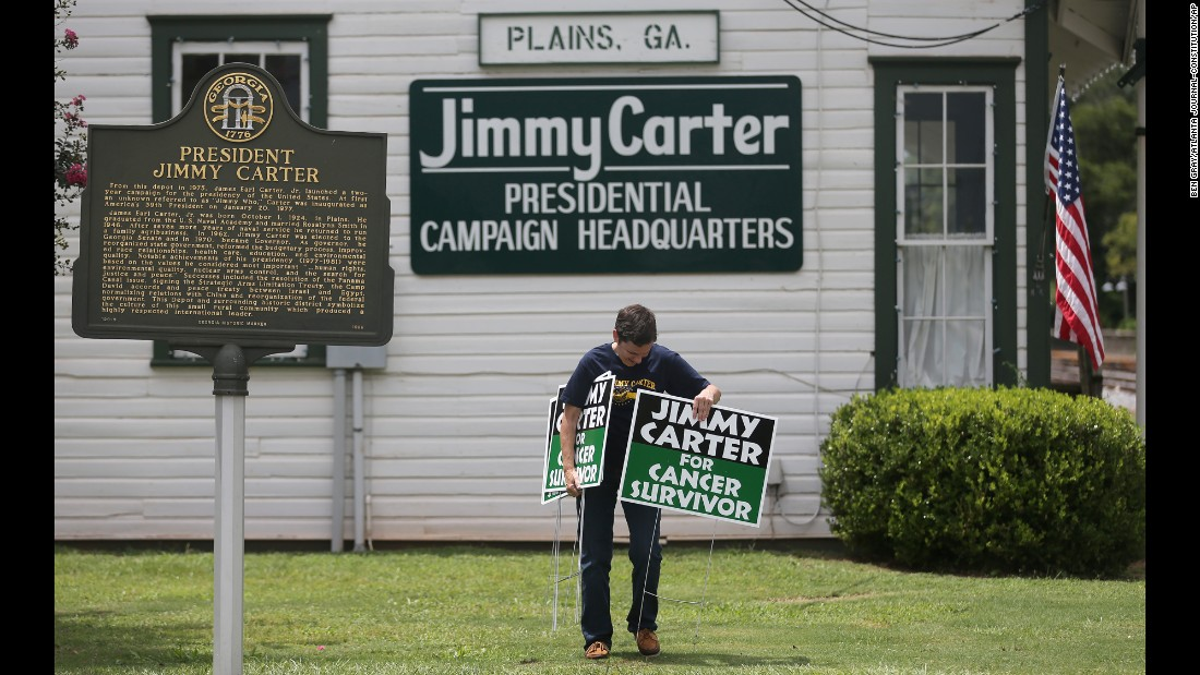 "Jill Stuckey places signs in front of Jimmy Carter's former campaign headquarters in Plains, Georgia, on Thursday, August 20. During a news conference in Atlanta that day, the former U.S. President <a href=""http://www.cnn.com/2015/08/20/politics/jimmy-carter-cancer-update/index.html"" target=""_blank"">announced that he had cancer spots on his brain</a> and would immediately begin a regimen of treatment. Carter <a href=""http://www.cnn.com/2015/12/08/health/jimmy-carter-cancer-legacy/index.html"" target=""_blank"">announced in December</a> that he was cancer-free."