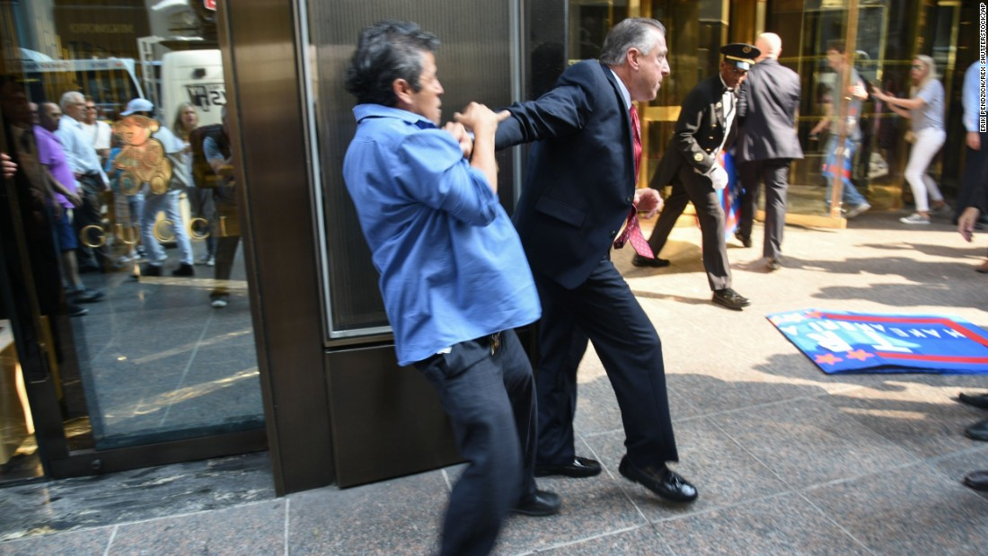 "Keith Schiller, Donald Trump's director of security and longtime bodyguard, holds back demonstrator Efrain Galicia at Trump Tower in New York on Thursday, September 3. Galicia was among five protesters who later <a href=""http://www.cnn.com/2015/09/09/politics/donald-trump-protesters-lawsuit/"" target=""_blank"">filed a lawsuit</a> against Schiller, Trump, Trump's campaign and his company. The plaintiffs allege that Trump security officials, namely Schiller, assaulted them as they protested outside of a campaign event."