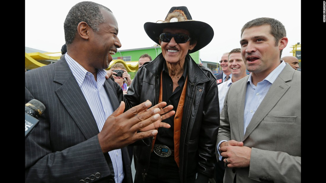 "Republican presidential candidate Ben Carson, left, talks with NASCAR legend Richard Petty, center, and Petty's grandson Austin while touring a camp for disabled children Monday, September 28, in Randleman, North Carolina. <a href=""http://www.cnn.com/2015/09/29/politics/ben-carson-confederate-flag/"" target=""_blank"">Carson said NASCAR fans should be free to fly the Confederate flag</a> as long as it's on private property. Richard Petty, who partly funds the Victory Junction camp Carson was visiting, called preoccupation with the flag ""a passing fancy."""