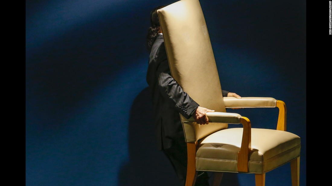 A man carries out a chair reserved for a head of state during the U.N. General Assembly in New York on Tuesday, September 29.