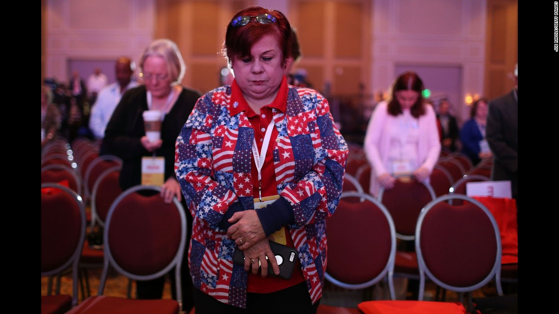 "People pray for victims of <a href=""http://www.cnn.com/2015/11/13/world/gallery/paris-attacks/index.html"" target=""_blank"">the Paris terrorist attacks</a> while attending the Sunshine Summit, an event in Orlando hosting Republican presidential candidates, on Saturday, November 14."