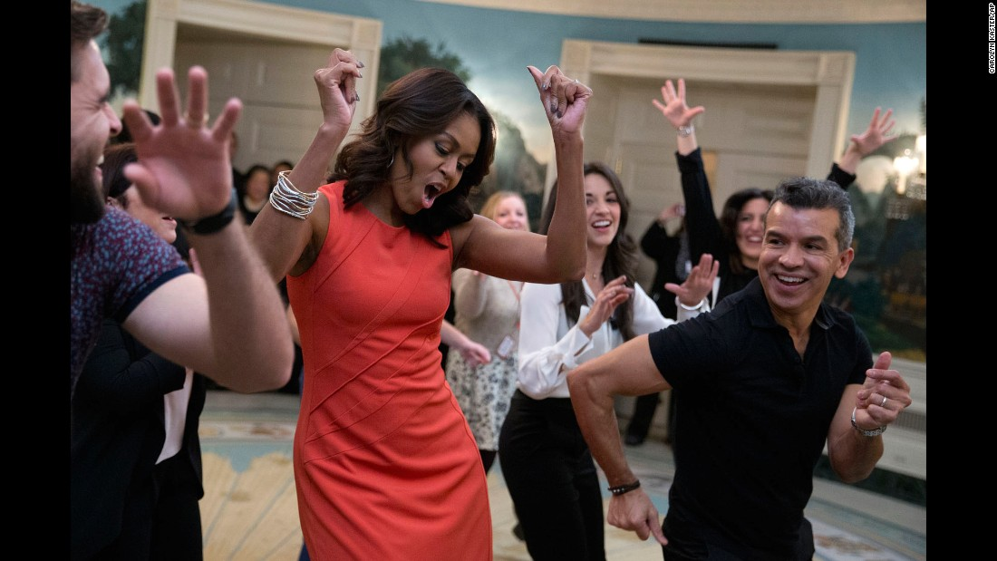 "First lady Michelle Obama dances to Gloria Estefan's ""Conga"" during an event at the White House on Monday, November 16. The ""Broadway at the White House"" event was for high school students involved in performing-arts programs."