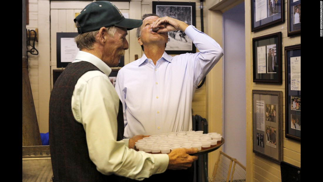 Ohio Gov. John Kasich, a Republican running for President, tastes maple syrup offered to him at a general store in North Woodstock, New Hampshire, on Wednesday, October 14.