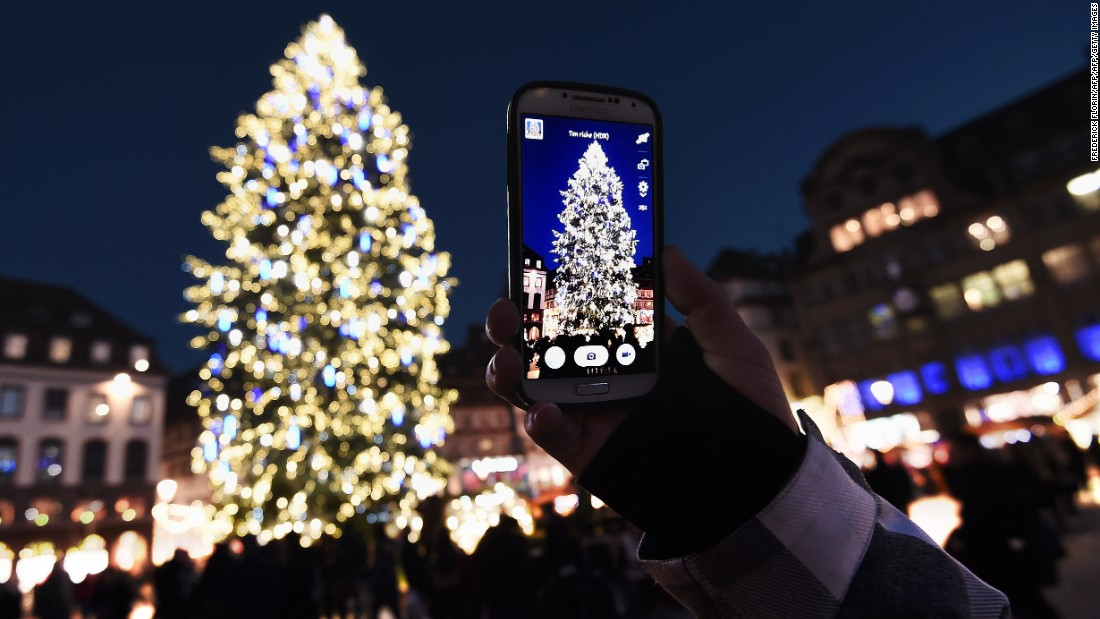 Twinkling lights, mulled wine, sweets, savories and festive handicrafts lure visitors to Christmas markets across Europe. Here, a market-goer captures a dazzling centerpiece at the Christmas market in Strasbourg, the largest and one of the oldest French Christmas markets.