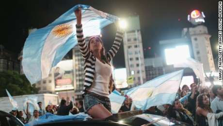 BUENOS AIRES, ARGENTINA - NOVEMBER 22: Supporters of President-elect Mauricio Macri wave Argentinian flags in the street celebrating after he defeated ruling party candidate Daniel Scioli in a runoff election on November 22, 2015 in Buenos Aires, Argentina. Argentina faced its first presidential election runoff in the history of the country with Macri winning and ending 12 years of Peronist rule. (Photo by Mario Tama/Getty Images,)