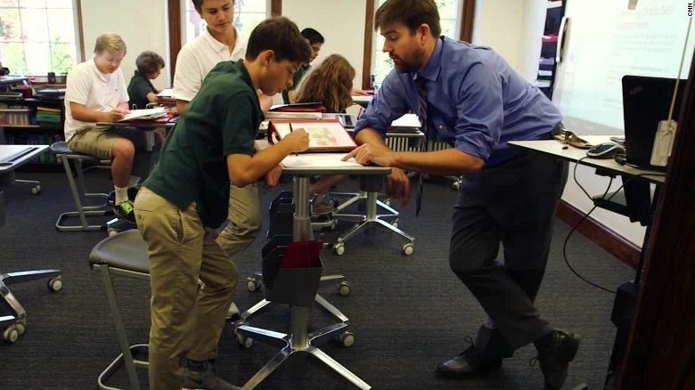 Students using standing desks to learn CNNcom