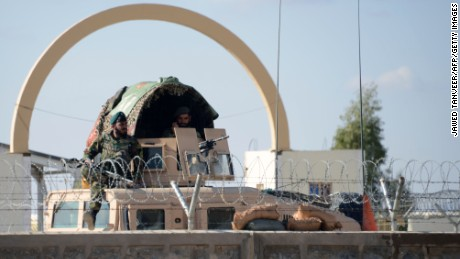 Afghan National Army soldiers keep watch after the airport attack.