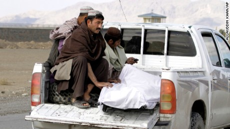 The body of a man killed at Kandahar Airfield is moved.