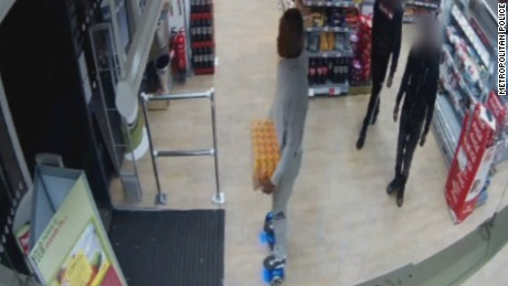 Detectives investigating a theft from a store in London, England have issued CCTV footage of a man on a hoverboard they are keen to identify.