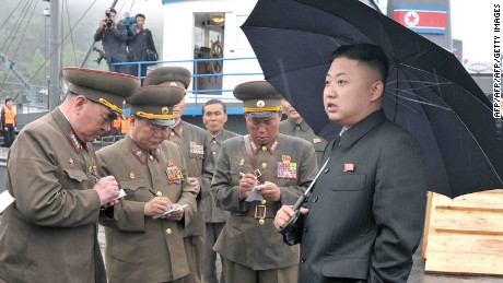 "This undated picture released by North Korea's official Korean Central News Agency (KCNA) on May 28, 2013 shows North Korean leader Kim Jong-Un (R, front) inspecting the August 25 Fishery Station under the Korean People's Army (KPA) Unit 313.   AFP PHOTO / KCNA via KNS    THIS PICTURE WAS MADE AVAIALBLE BY A THIRD PARTY. AFP CAN NOT INDEPENDENTLY VERIFY THE AUTHENTICITY, LOCATION, DATE AND CONTENT OF THIS IMAGE. THIS PHOTO IS DISTRIBUTED EXACTLY AS RECEIVED BY AFP. AFP PHOTO / KCNA via KNS ---EDITORS NOTE--- RESTRICTED TO EDITORIAL USE - MANDATORY CREDIT ""AFP PHOTO / KCNA VIA KNS"" - NO MARKETING NO ADVERTISING CAMPAIGNS - DISTRIBUTED AS A SERVICE TO CLIENTS ---        (Photo credit should read KCNA/AFP/Getty Images)"