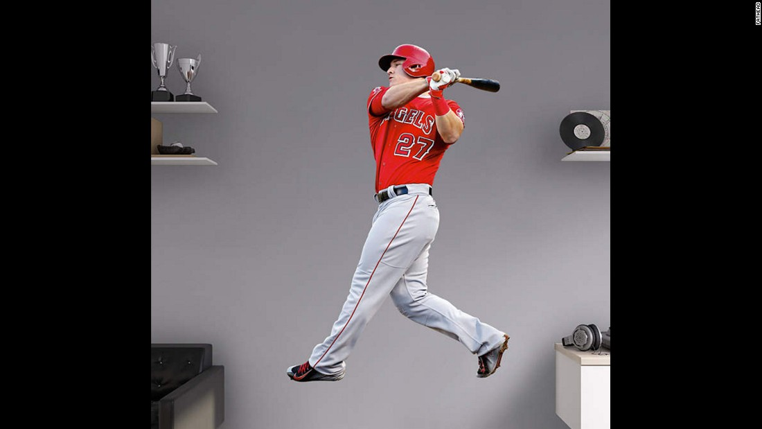 "Brighten your kid's bedroom wall with these <a href=""http://www.fathead.com/mlb/la-angels/mike-trout-swinging-wall-decal/"" target=""_blank"">life-size decals of sports heroes</a>, from football to soccer and beyond. This one of Angels star Mike Trout is more than 6 feet tall."