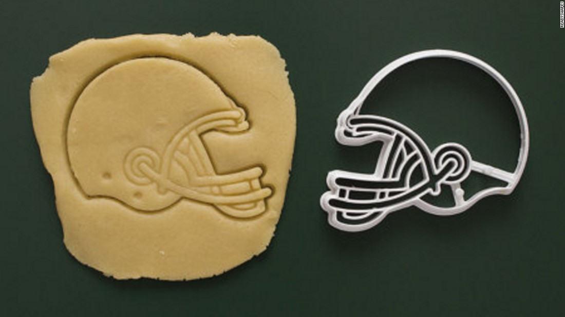 "If your loved one's hobbies are as varied as baking and sports, then a football-shaped cookie cutter could be just the right stocking suffer. <a href=""https://www.etsy.com/listing/235215578/football-helmet-cookie-cutter-3d-printed?ref=market"" target=""_blank"">Made by Readyshapes and available on Etsy</a>, these plastic, 3D-printed baking tools come in the form of helmets, footballs, soccer balls and baseballs."
