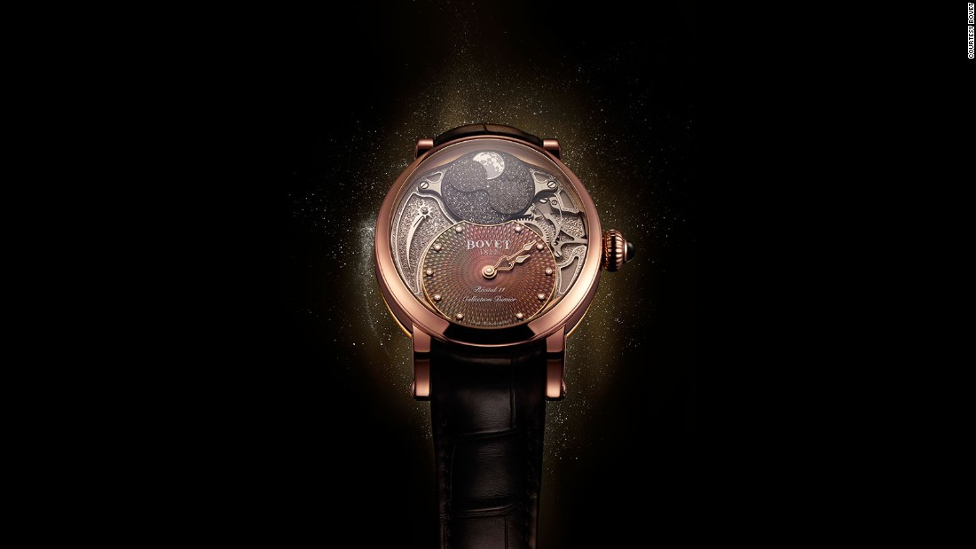 "The Récital 11 ""Miss Alexandra"" by Bovet is a women's watch named after the daughter of Pascal Ravy, the owner of the company. It features a moonphase with two black moons on a moving disc."