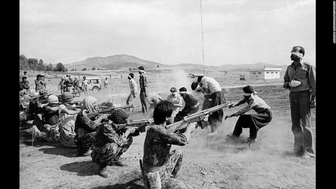 "After a brief Iranian show trial, 11 people who were charged as ""counterrevolutionary"" were executed at Iran's Sanandaj Airport on August 27, 1979. Nine of the 11 men being executed in this image were Kurds. This photo won the Pulitzer Prize in 1980. The recipient was known as ""anonymous"" until 2006, when Jahangir Razmi told the Wall Street Journal that he had taken the photograph."