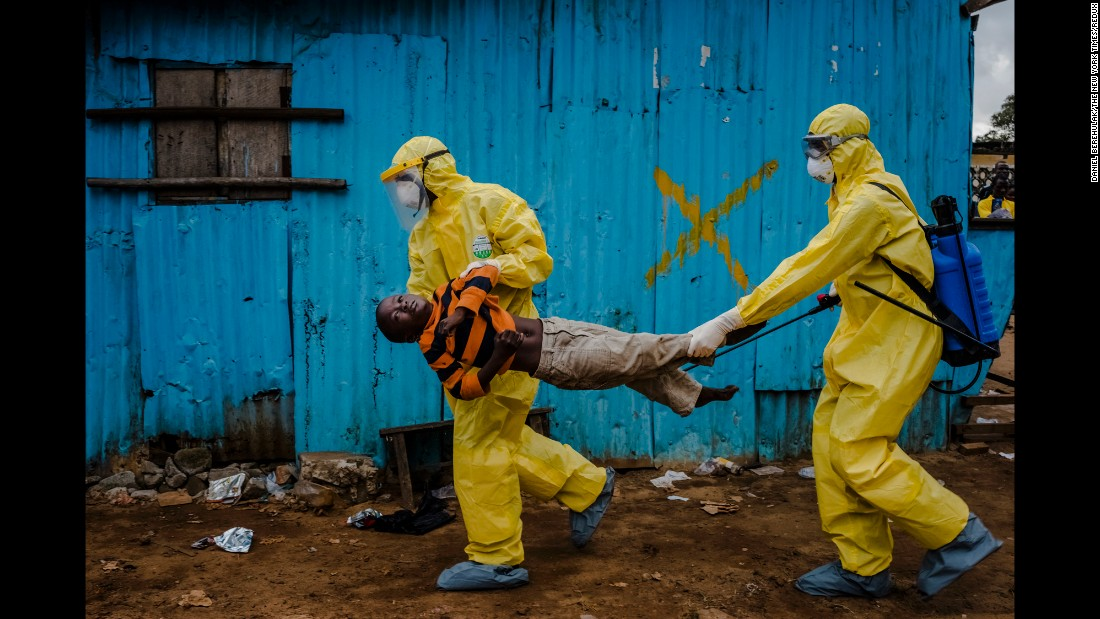 James Dorbor, 8, who doctors feared was infected with Ebola, is carried to a treatment facility in Monrovia, Liberia, on September 5, 2014. Daniel Berehulak was awarded the Pulitzer Prize for feature photography on April 20, 2015, for his coverage of the Ebola outbreak in West Africa for The New York Times. Berehulak used a Nikon digital camera with various lenses and exposures.