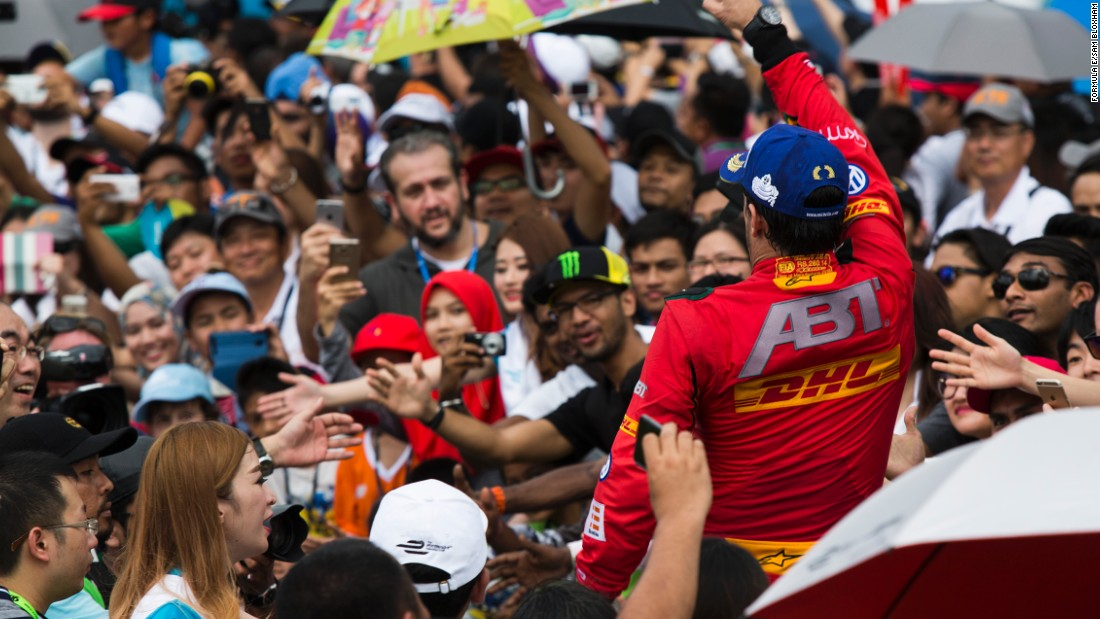 Fans have the chance to get closer to the action in Formula E. Here, Brazil's Di Grassi feels the love after his Malaysia success.