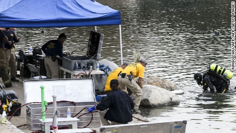 An FBI dive team conducts a search for any evidence, that may have been left by the husband and wife behind the San Bernardino massacre,  at Seccombe Lake Park, in San Bernardino, California, on December 10, 2015. David Bowdich, assistant director of the FBI's office in Los Angeles, told reporters there were indications that US-born Syed Farook and his Pakistani wife Tashfeen Malik had visited the park where Seccombe Lake is located on the day of the December 2 attack or previously.  AFP PHOTO/ RINGO CHIURINGO CHIU/AFP/Getty Images