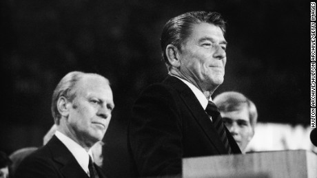 President Gerald Ford listens as Ronald Reagan delivers a speech during the closing session of the Republican National Convention on August 19, 1976 in Kansas City, Missouri.