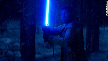 "Finn in ""The Force Awakens"" with Luke's lightsaber."