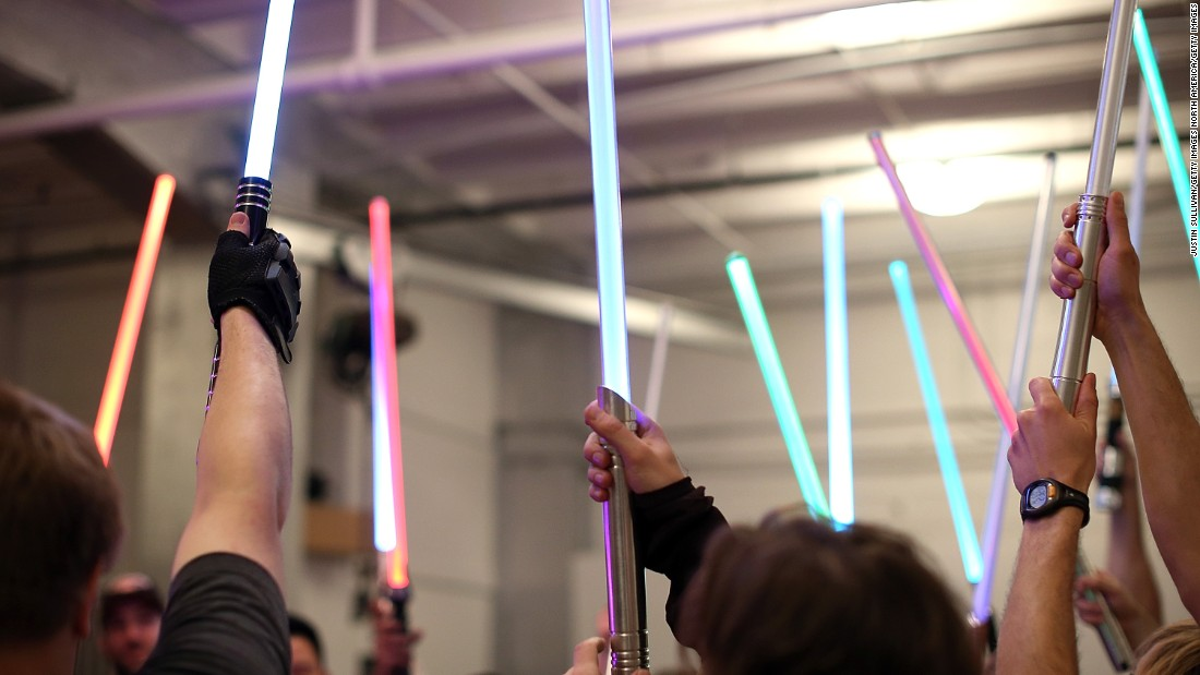 Students hold up their lightsabers during a Golden Gate Knights class in saber choreography in San Francisco, California.