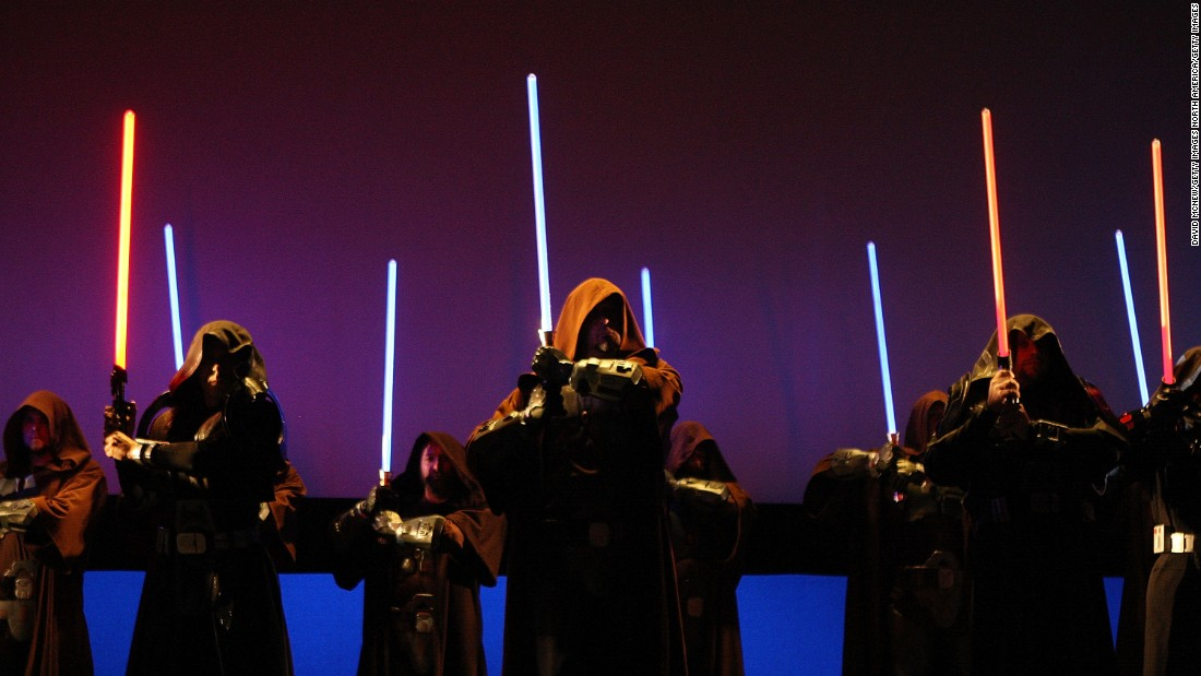 Characters wielding lightsabers take to the stage to promote Star Wars The Old Republic at the Entertainment Software Association (ESA) press conference leading up to opening day of the 2009 E3 Expo on June 1, 2009 in Los Angeles, California.