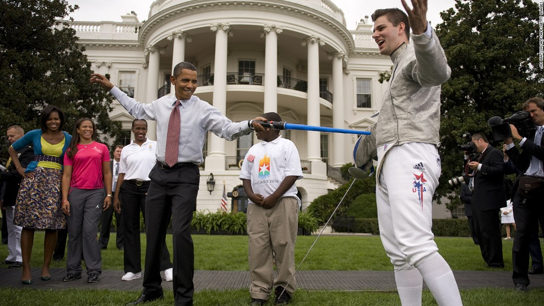 U.S. President Barack Obama fences with Olympic Fencer Tim Morehouse with a lightsaber.