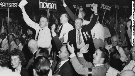 Members of the Michigan delegation at the Republican National Convention in Philadelphia Pennsylvania, jump to their feet and cheer as Thomas Edward Dewey's landslide victory as Republican nominee for president is announced on June  24,1948.