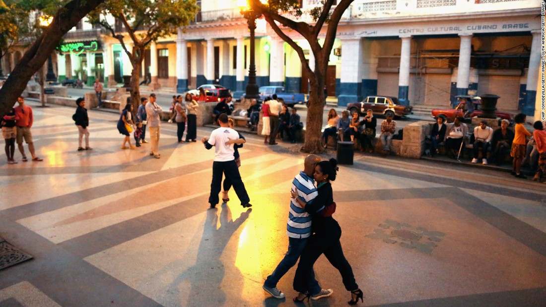 Cubans dance the tango in the middle of the famous Prado boulevard in Habana Vieja.