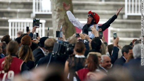Frankie Dettori atop Golden Horn celebrating what was his fourth win at the Prix De L'Arc De Triomphe -- Europe's richest turf race.