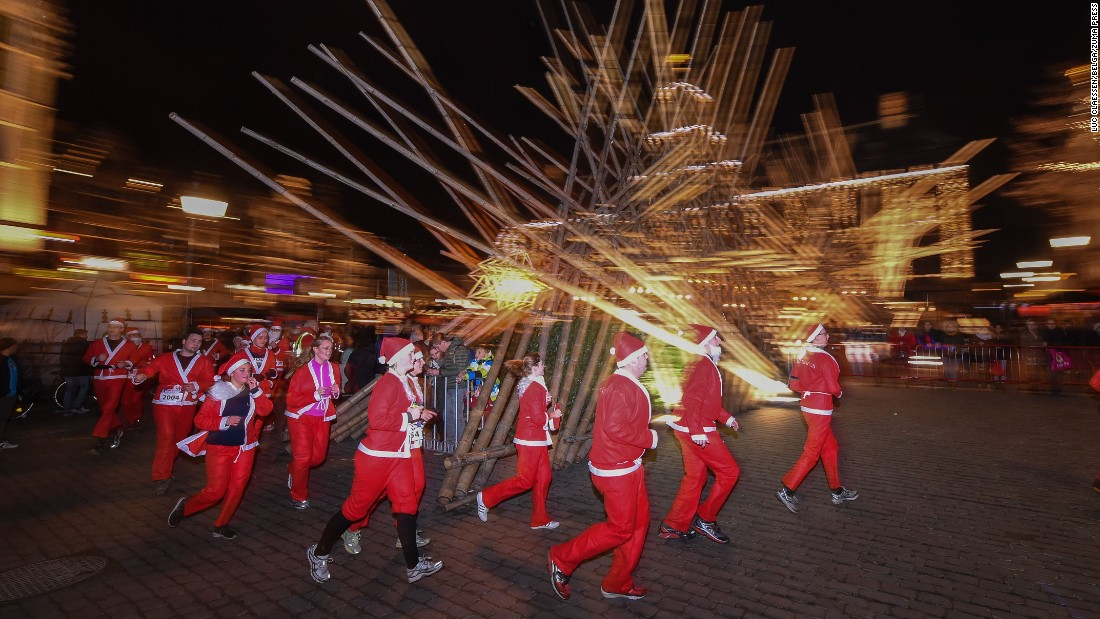 Runners dressed as Santa Claus make their way through the Grote Markt in Antwerp, Belgium, during a Santa Run on Saturday December 12.