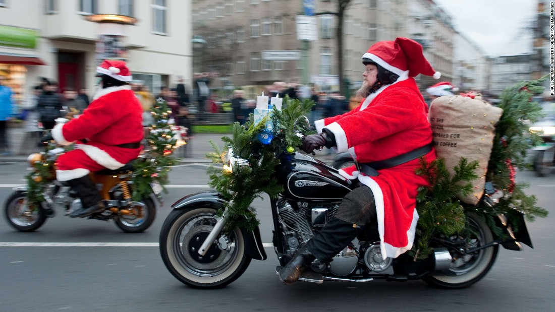"Men costumed as Santa Claus ride motorcycles during the annual  ""Berlin Christmas Biketour"" in Berlin, Germany,."