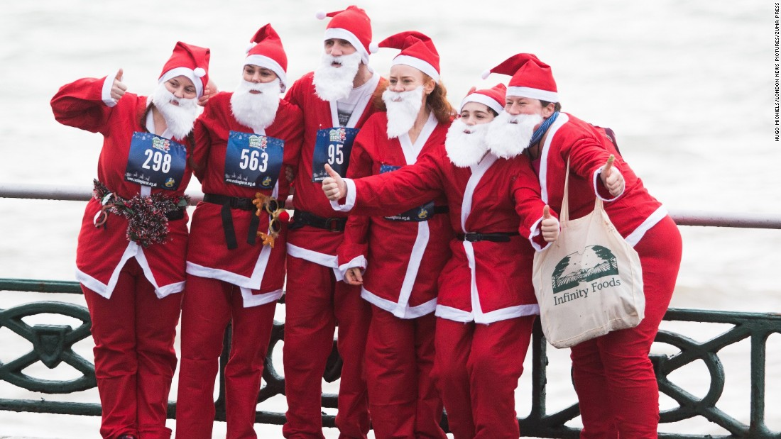 Runners taking part in the yearly Brighton Santa Dash in aid of Brighton's Chrildren's Charity Rockinghorse, pose for a photograph in East Sussex, England.