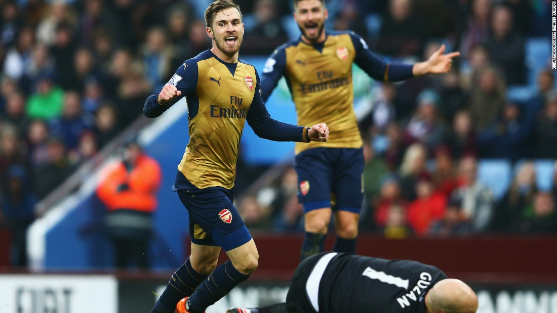 Aaron Ramsey of Arsenal celebrates as he scores his team's second goal against Aston Villa at Villa Park. Arsenal topped the standings after the 2-0 victory.