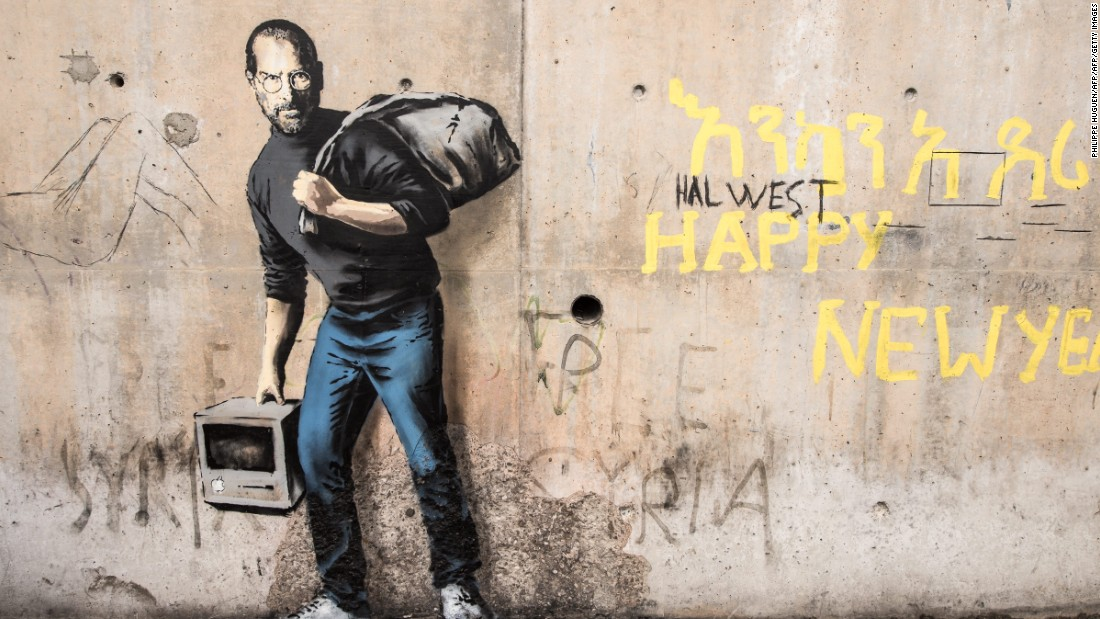 This image one, painted on a concrete bridge in December, depicts the late Steve Jobs, co-founder and CEO of Apple.