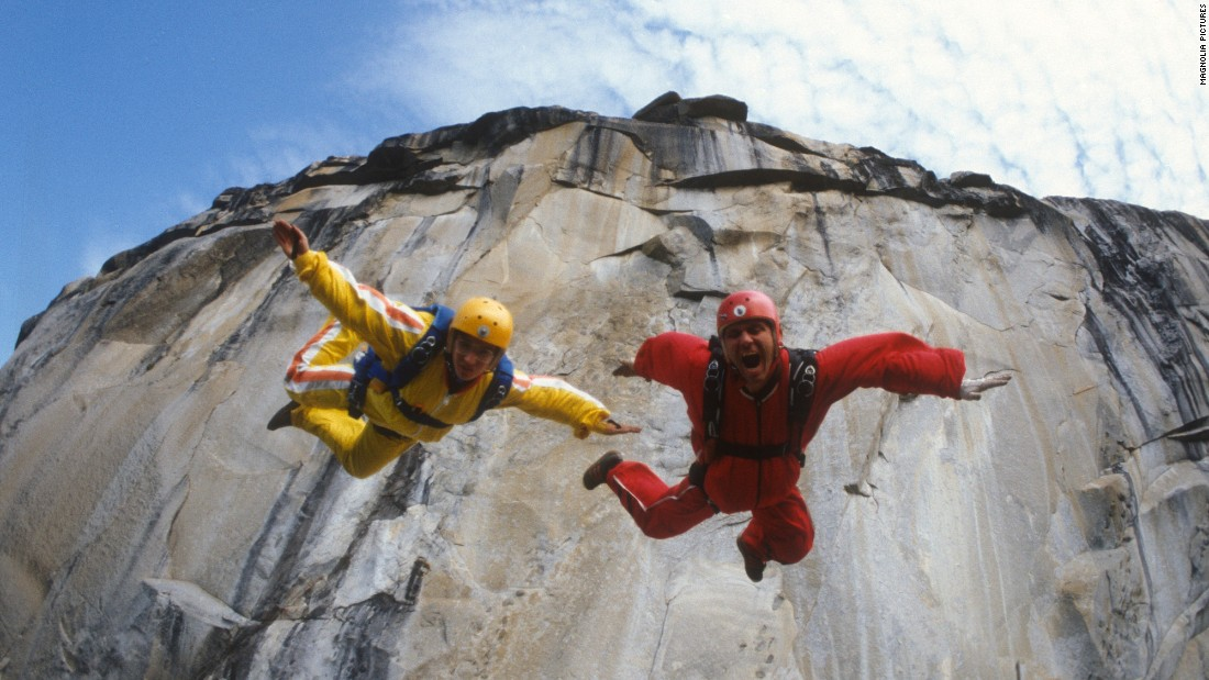 "Carl Boenish and his wife, Jean, leap from a cliff in the early days of BASE jumping, an extreme sport in which participants jump from fixed objects and use parachutes to slow their falls. Carl Boenish is considered the ""father"" of BASE jumping, and his amazing life story is the subject of <a href=""http://www.cnn.com/shows/cnn-films-sunshine-superman"">CNN Films' ""Sunshine Superman."" </a>"
