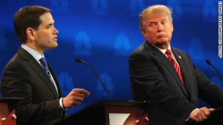 Presidential candidates Sen. Marco Rubio (L)  (R-FL) speaks while Donald Trump looks on during the CNBC Republican Presidential Debate at University of Colorados Coors Events Center October 28, 2015 in Boulder, Colorado.