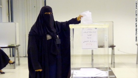A Saudi woman casts her ballot in an election centre in the Saudi capital of Riyadh, on December 12, 2015. Saudi women were allowed to vote in elections for the first time ever, in a tentative step towards easing widespread sex discrimination in the ultra-conservative Islamic kingdom. AFP PHOTO / DINA FOUAD / AFP / DINA FOUAD        (Photo credit should read DINA FOUAD/AFP/Getty Images)