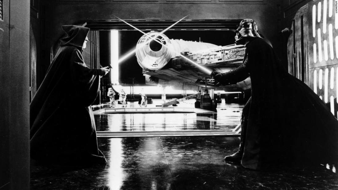 "Obi-Wan Kenobi and Darth Vader duke it out in front of the Millennium Falcon in ""A New Hope."" The spaceship was constructed in a hanger in Leavesden, the original surroundings looking like the Mos Eisley port. Once those scenes were shot the set was dressed as the docking bay from the Death Star."