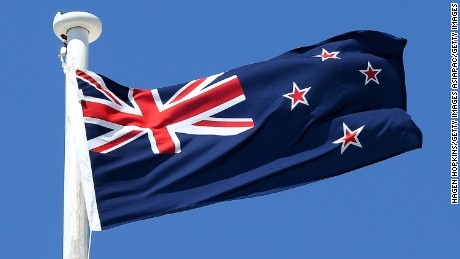 The current New Zealand flag features the Union Jack and four stars representing the Southern Cross.