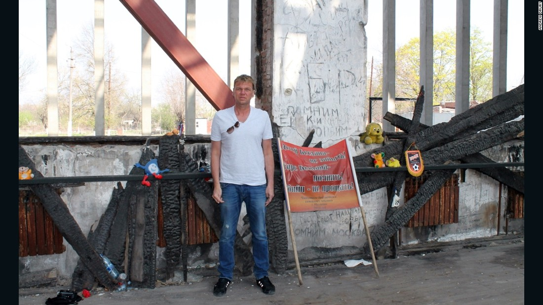 "2011: At Beslan school in Chechnya, where 385 people died after being taken hostage by terrorists in 2004. Drury believes visiting such ""dark sites"" can further his understanding of humanity, history and politics."