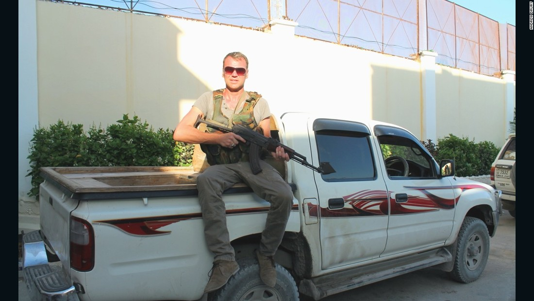 Drury started visiting danger zones for the excitement and enjoyed getting close to military action. Here he's pictured in Mogadishu with a weapon borrowed from his security detail. <br />