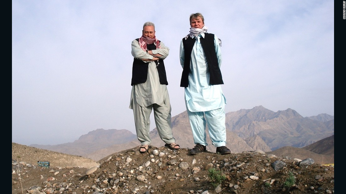 2009: Drury and cousin Green wear local outfits up a mountain in Tora Bora, Afghanistan -- once thought to be the hiding place of Al Qaeda leader Osama bin Laden.