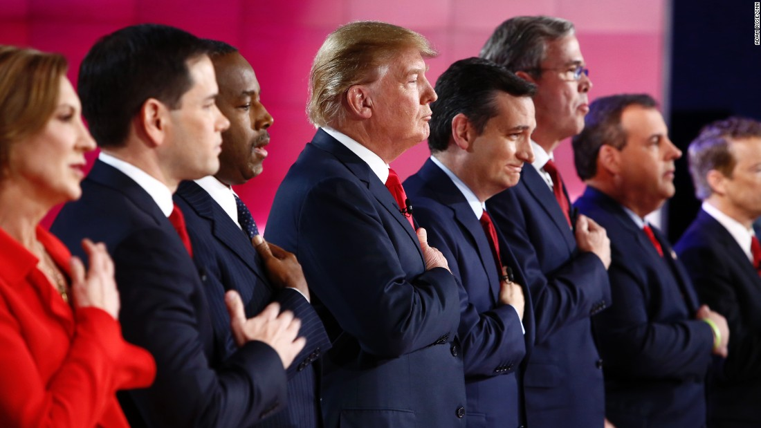 The candidates put their hands over the hearts during the national anthem.